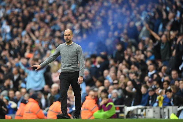 """I realised this season how difficult it will be to win the Champions League,"" said Guardiola, who lifted the European Cup as both a player and manager at Barcelona (AFP Photo/Paul ELLIS)"