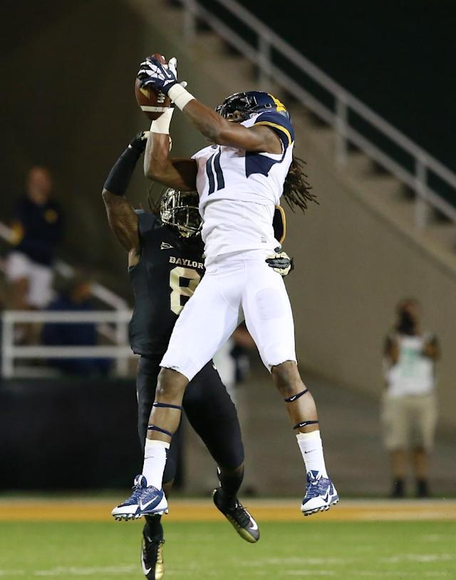 West Virginia wide receiver Kevin White (11) pulls down a pass over Baylor cornerback K.J. Morton (8), left, during the first half of an NCAA college football game on Saturday, Oct. 5, 2013, in Waco, Texas. (AP Photo/Jose Yau)