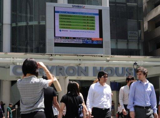 "A stocks display board in the financial district of Raffles place in Singapore. In a statement posted on the Singapore Exchange website, F&N said it had ""reached a mutual agreement with Heineken to extend the deadline for acceptance of the Heineken offer by one week from 27 July 2012"""