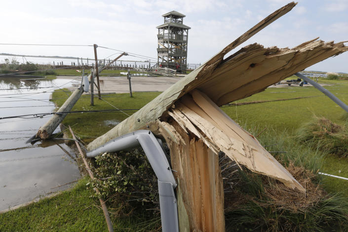 Utility poles were shipped after Hurricane Dorian moved through the area yesterday along a causeway in Nags Head, NC., Saturday, Sept. 7, 2019. (AP Photo/Steve Helber)