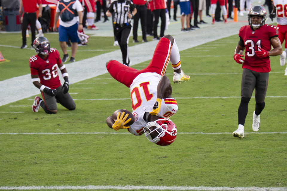 FILE - In this Nov. 29, 2020 file photo, Kansas City Chiefs wide receiver Tyreek Hill (10) does a back flip into the end zone to score a touchdown against the Tampa Bay Buccaneers during an NFL football game in Tampa, Fla. Hill was unstoppable against Tampa Bay in late November. The speedy Kansas City star caught 13 passes for 269 yards and three touchdowns in the Chiefs' 27-24 victory that afternoon. Tampa Bay gets another shot at Hill and the Chiefs in the Super Bowl on Sunday, Feb. 7, 2021. (AP Photo/Doug Murray, File)