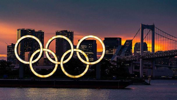 PHOTO: The Olympic rings floating on a barge in Tokyo Bay in front of the Rainbow Bridge, in Tokyo, July 20, 2021. (Richard Ellis/UPI/Shutterstock)