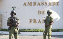 Tanzanian security forces guard an entrance to the French embassy after an attacker wielding an assault rifle was killed in the Salenda area of Dar es Salaam
