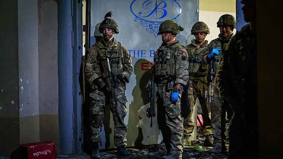 British soldiers secure the perimeter outside the Baron Hotel, on a road that leads to the Abbey Gate, in Kabul, Afghanistan - 26 August 2021