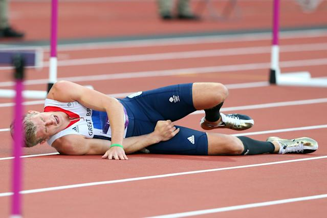 LONDON, ENGLAND - AUGUST 04: Jack Green of Great Britain lies after falling in the Men's 400m Hurdles Semi Final on Day 8 of the London 2012 Olympic Games at Olympic Stadium on August 4, 2012 in London, England. (Photo by Alexander Hassenstein/Getty Images)