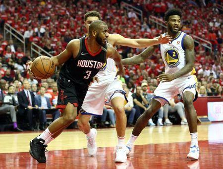 May 24, 2018; Houston, TX, USA; Houston Rockets guard Chris Paul (3) is guarded by Golden State Warriors guard Klay Thompson (11) and center Jordan Bell (2) in game five of the Western conference finals of the 2018 NBA Playoffs at Toyota Center. Mandatory Credit: Troy Taormina-USA TODAY Sports
