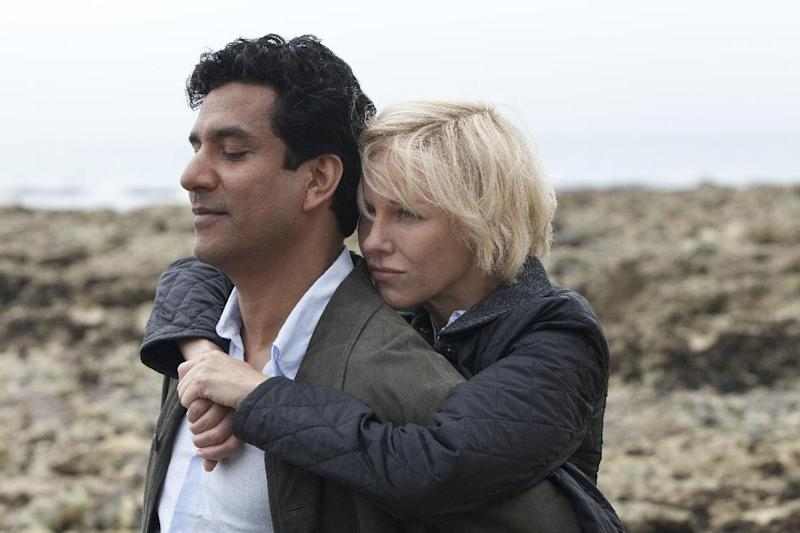 "This film image released by Entertainment One Films shows Naveen Andrews as Dr. Hasnat Khan, left, and Naomi Watts as Diana, Princess of Wales, in a scene from ""Diana."" (AP Photo/Entertainment One Films, Laurie Sparham)"
