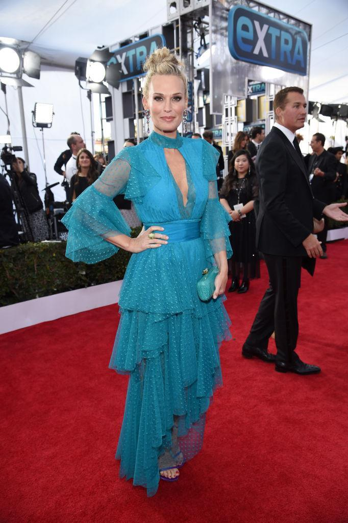 <p>Sims rocked a tiered turquoise gown with purple Stuart Weitzman heels. (Photo: Getty Images) </p>