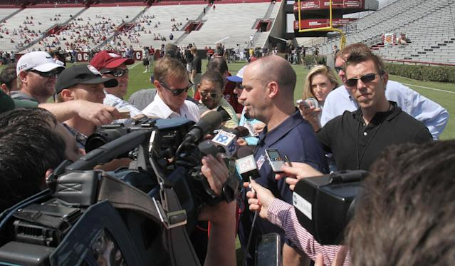 Houston Texan's coach Bill O'Brien fields questions from the media after watching South Carolina defensive end Jadeveon Clowney compete in a drillfor NFL representatives at South Carolina football pro day in Columbia, S.C., Wednesday, April 2, 2014. (AP Photo/Mary Ann Chastain)