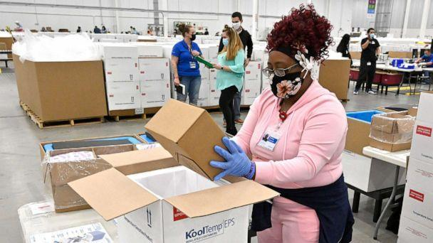 PHOTO: An employee with the McKesson Corporation packs a box of the Johnson and Johnson COVID-19 vaccine into a cooler for shipping from their facility in Shepherdsville, Ky., March 1, 2021. (Timothy D. Easley/AP)