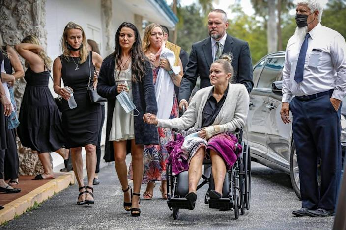 Tayler Scheinhaus holds hands with her mother, Angela Gonzalez, as they arrive for the funeral services for Edgar Gonzalez, Angela's husband and Tayler's stepfather, at Christ Fellowship Church in Palmetto Bay on Friday, July 23, 2021. Edgar Gonzalez died during the June 24, 2021, collapse of the 12-story oceanfront condo, Champlain Towers South in Surfside. Angela fell from the ninth to fifth floor in the collapse. Tayler had left the condo about two hours before the collapse.