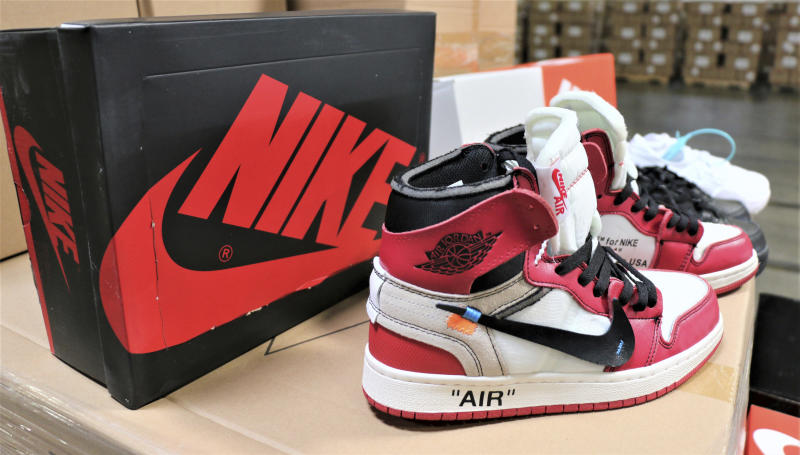 This undated photo provided by U.S. Customs and Border Protection shows some of more than 14,800 pair of counterfeit Nike shoes, seized in a shipment arriving from China at the Los Angeles-Long Beach sports complex. The agency said Wednesday, Oct. 9, 2019 that had the fake special edition and retro design shoes been real, the manufacturer's suggested retail prices would have totaled more than $2.2 million. The agency says the shoes violated trademarks for various versions of Nike's Air Jordan and Air Max shoes. (U.S. Custom and Border Protection via AP)