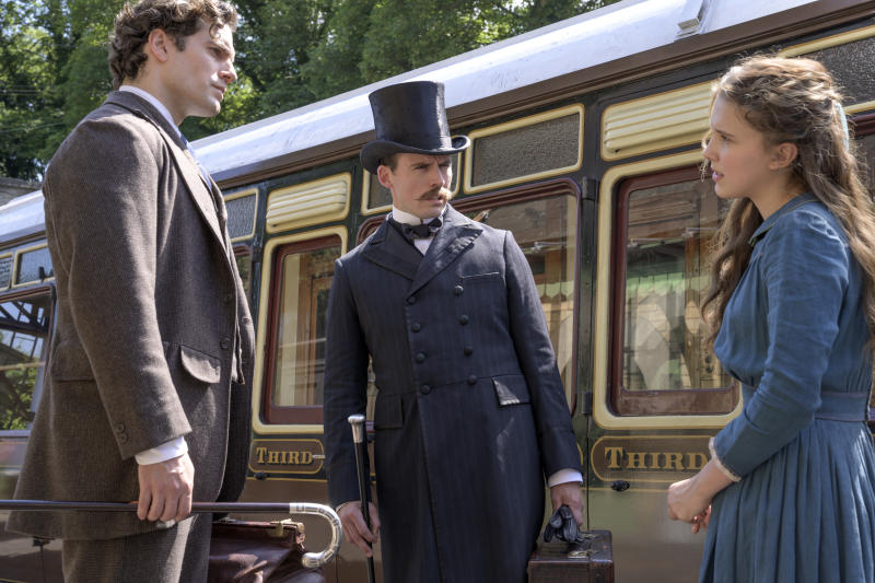 Sherlock (Henry Cavill), Mycroft (Sam Claflin), and Enola (Millie Bobby Brown) form the dysfunctional Holmes clan of Nancy Springer's booksALEX BAILEY/LEGENDARY ©2020