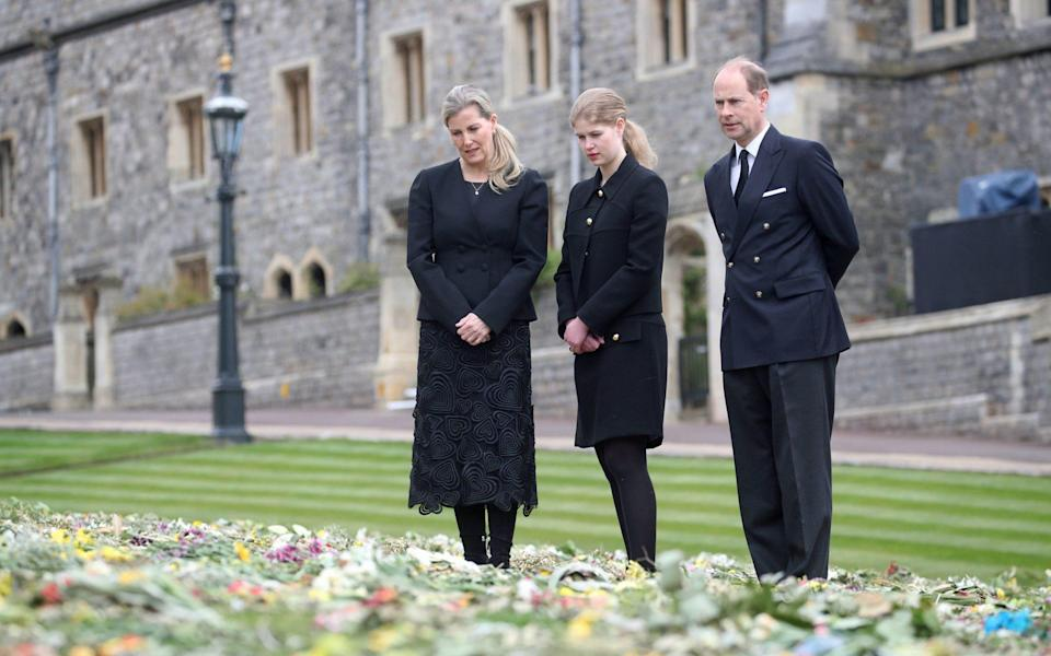 The Countess of Wessex, Lady Louise Windsor and the Earl of Wessex view flowers outside St George's Chapel, at Windsor Castle, Berkshire - Steve Parsons