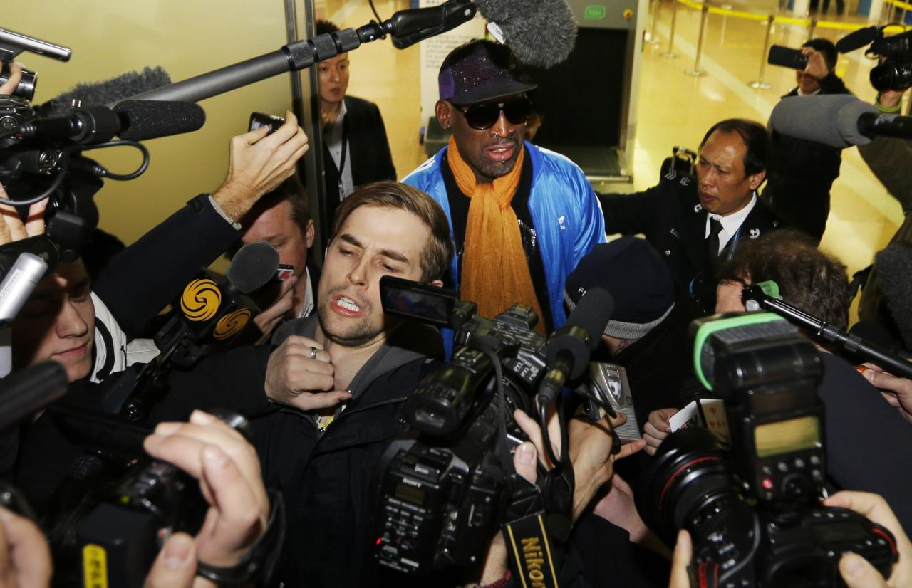 Former NBA basketball player Dennis Rodman speaks to the media upon his arrival from North Korea's Pyongyang, at Beijing Capital International Airport, January 13, 2014. REUTERS/Jason Lee (CHINA - Tags: POLITICS SPORT BASKETBALL MEDIA ENTERTAINMENT)