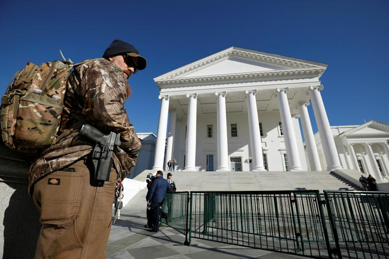 A gun rights activist carries a handgun in a hip holster outside the Virginia State Capitol building