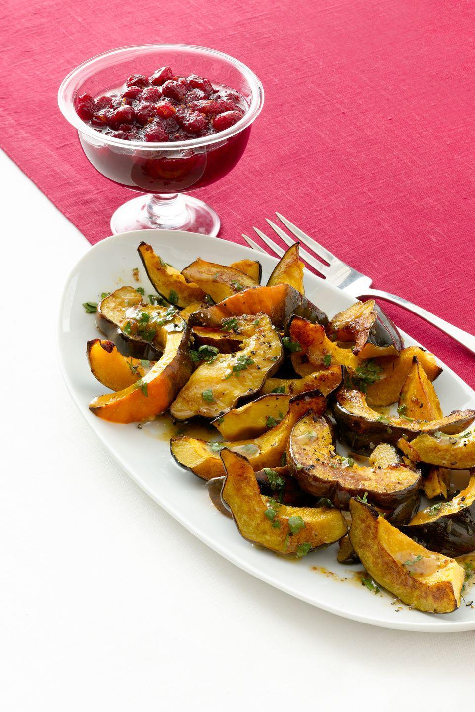 """<p>Bring additional seasonal ingredients to the Thanksgiving table this year with apple cider-roasted acorn squash doused in a cider vinaigrette.</p><p><a href=""""https://www.womansday.com/food-recipes/food-drinks/recipes/a12206/roasted-acorn-squash-with-cider-vinaigrette-recipe-wdy1112/"""" rel=""""nofollow noopener"""" target=""""_blank"""" data-ylk=""""slk:Get the Roasted Acorn Squash with Cider Vinaigrette recipe."""" class=""""link rapid-noclick-resp""""><em><strong>Get the Roasted Acorn Squash with Cider Vinaigrette recipe.</strong></em></a></p>"""