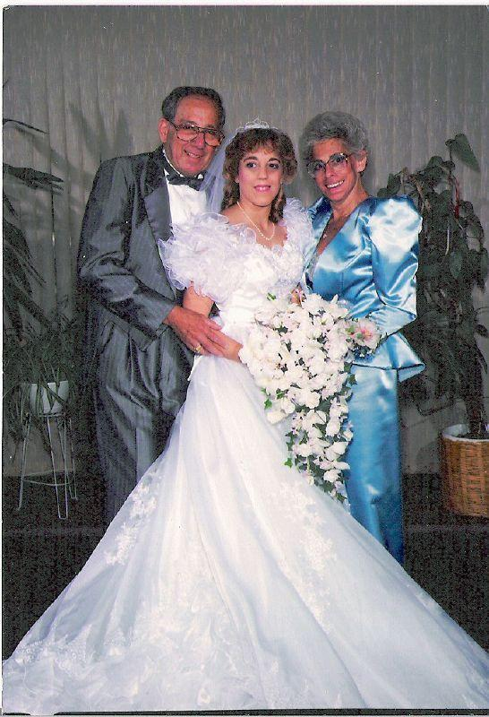 """<p>The frilly details at the shoulders of this 1988 wedding dress bring to mind the frothy-sleeved gowns often seen on the <a href=""""http://www.glamamor.com/2014/07/GingerRogers-SwingTime-BernardNewman.html"""" rel=""""nofollow noopener"""" target=""""_blank"""" data-ylk=""""slk:silver screen in the 1930s"""" class=""""link rapid-noclick-resp"""">silver screen in the 1930s</a>. </p>"""
