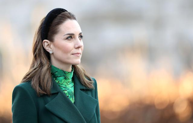 The duchess takes a moment after laying a wreath with her husband. (Getty Images)
