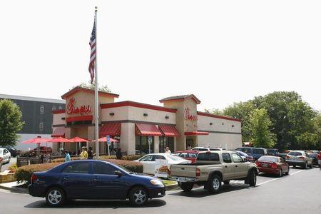 Cars surround a Chick-Fil-A restaurant during lunch time in Decatur, Georgia, August 3, 2012. REUTERS/Tami Chappell