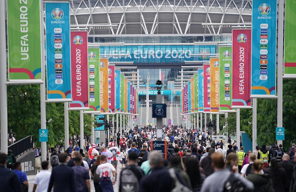 Fans outside Wembley Stadium ahead of the Euro 2020 semi-final match between England and Denmark (PA Wire)