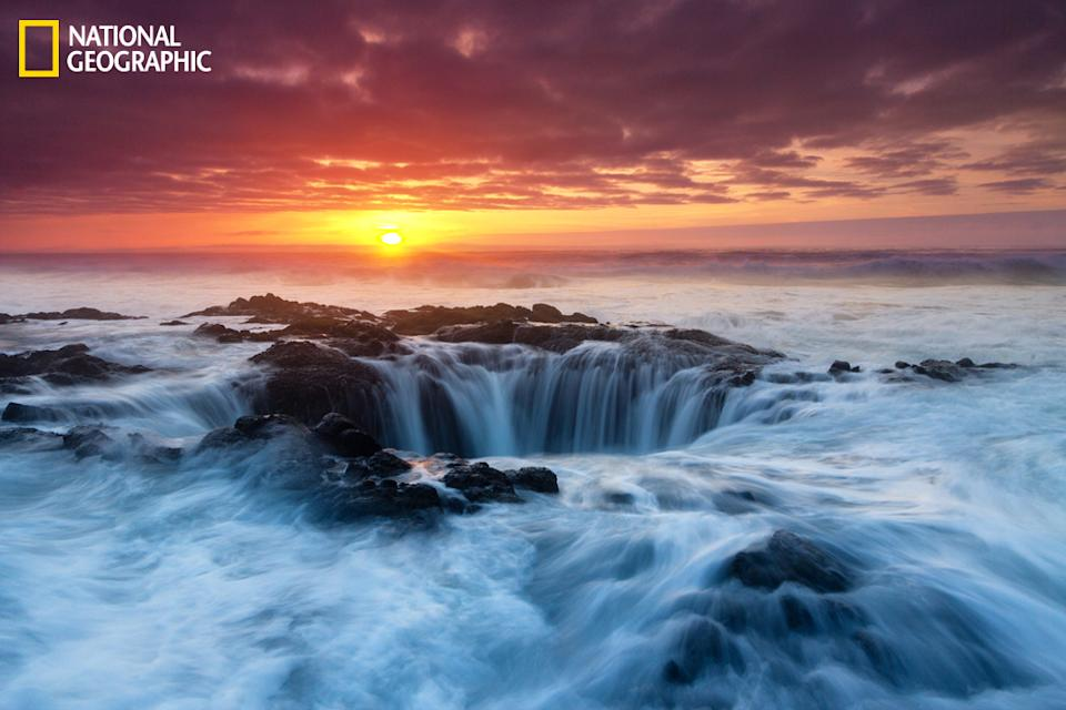 """I am so gravitated to this spot on the Oregon coast, called Thor's Well. Water shoots straight up this hole and waves come crashing in on either side of you. It's a dangerous, adrenaline-pumping experience. Tides were particularly dangerous this day. In fact, the risk became a reality when a big wave came in and knocked me and my camera down. I was in full waders, but I was no match for the force of the surf. Lucky for me I just scuffed my knee and there was no equipment damage. (Photo and caption Courtesy Majeed Badizadegan / National Geographic Your Shot) <br> <br> <a href=""""http://ngm.nationalgeographic.com/your-shot/weekly-wrapper"""" rel=""""nofollow noopener"""" target=""""_blank"""" data-ylk=""""slk:Click here"""" class=""""link rapid-noclick-resp"""">Click here</a> for more photos from National Geographic Your Shot."""