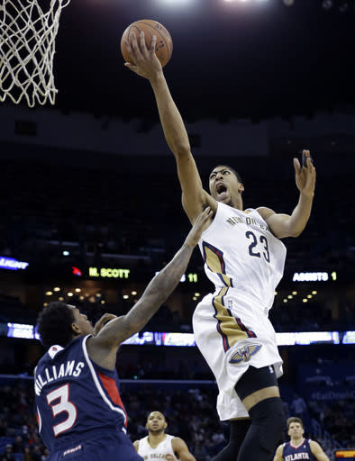 New Orleans Pelicans power forward Anthony Davis (23) goes to the basket over Atlanta Hawks shooting guard Louis Williams (3) in the second half of an NBA basketball game in New Orleans, Wednesday, Feb. 5, 2014. The Pelicans won 105-100. (AP Photo/Gerald Herbert)