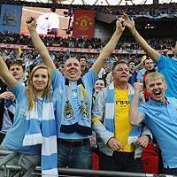 Manchester City fans celebrate as their team secures them bragging rights over rivals from Manchester United