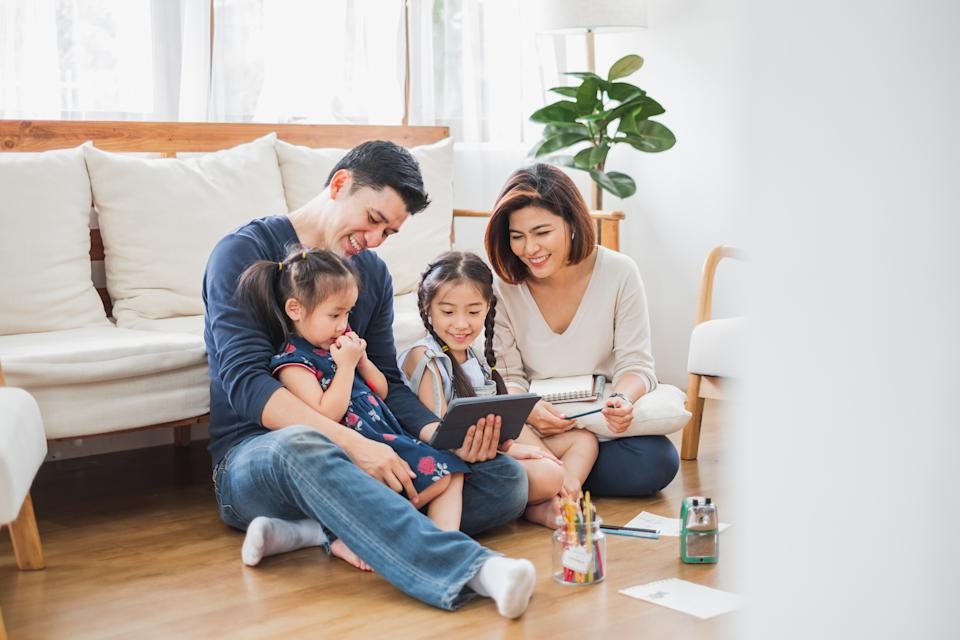 Happy Asian family relaxing at home