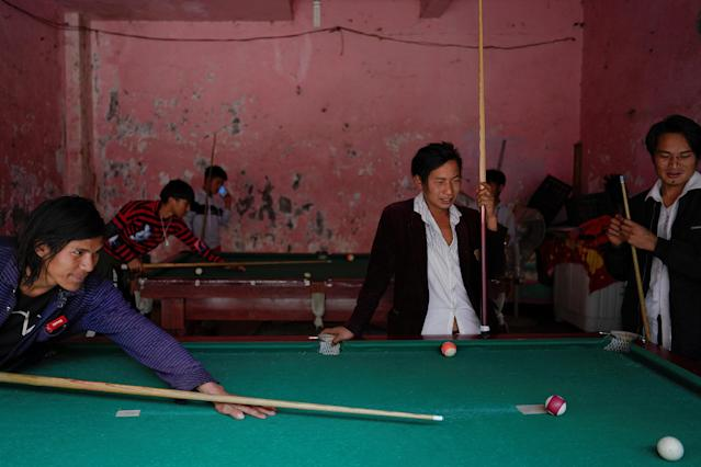 "Ethnic Lisu men play a game of billiards in Daxindi township of Nujiang Lisu Autonomous Prefecture in Yunnan province, China, March 24, 2018. REUTERS/Aly Song SEARCH ""SONG CROSSBOW"" FOR THIS STORY. SEARCH ""WIDER IMAGE"" FOR ALL STORIES. TPX IMAGES OF THE DAY."