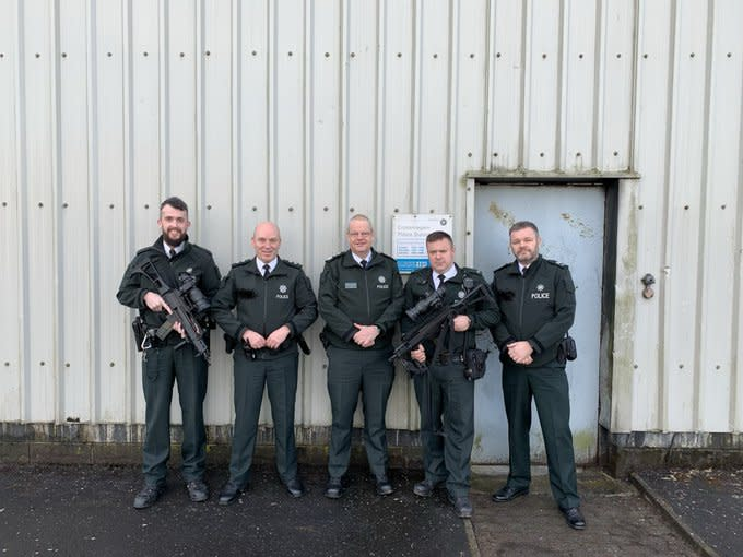 Constable Simon Byrne tweeted an image showing him standing with colleagues in Crossmaglen on Christmas Day (Picture: Twitter/Constable Simon Byrne)