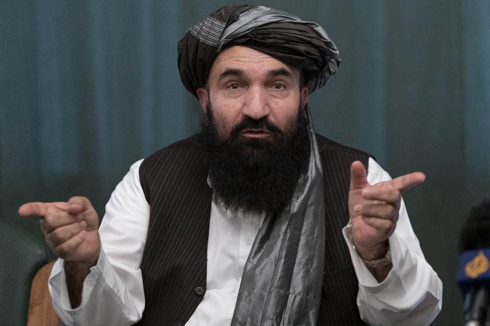 """Khairullah Khairkhwa, former western Herat Governor and one of five Taliban released from the U.S. prison on Guantanamo Bay in exchange for U.S. soldier Bowe Bergdahl, gestures during a joint news conference in Moscow, Russia, Friday, March 19, 2021. The Taliban warned Washington against defying a May 1 deadline for the withdrawal of American and NATO troops from Afghanistan promising a """"reaction"""". (AP Photo/Alexander Zemlianichenko, Pool)"""