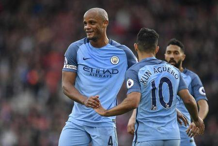 Manchester City's Sergio Aguero celebrates scoring their third goal with Vincent Kompany