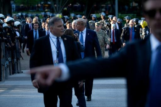 US President Donald Trump walks walks across Lafayette Square in a stage-managed show of force