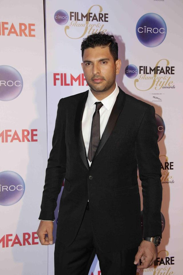 Mumbai: Cricketer, Yuvraj Singh during the Filmfare Glamour and Style Awards in Mumbai on Feb 26, 2015. (Photo: IANS)
