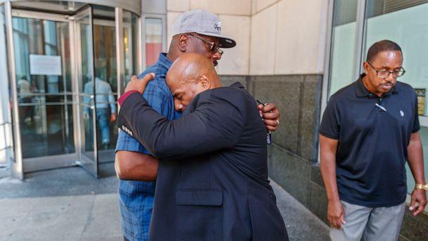 PHOTO: Chester Hollman III, right, buries his head into the chest of his uncle, David Hollman, as the two hugged outside of the Criminal Justice Center. (Michael Bryant/The Philadelphia Inquirer/TNS/Newscom)