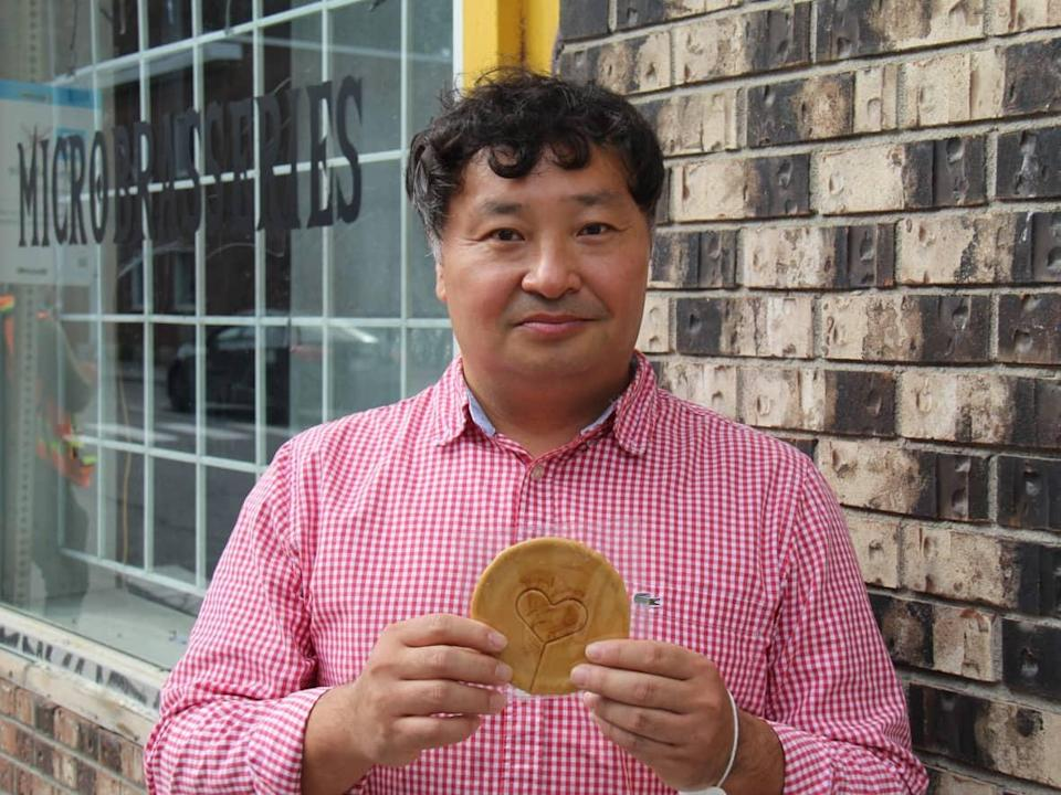 Robert Kim, originally from South Korea, has owned and operated Dépanneur Chez Claude & Claudette, located on Saint-Antoine Street, for 26 years.  (Rowan Kennedy/CBC - image credit)