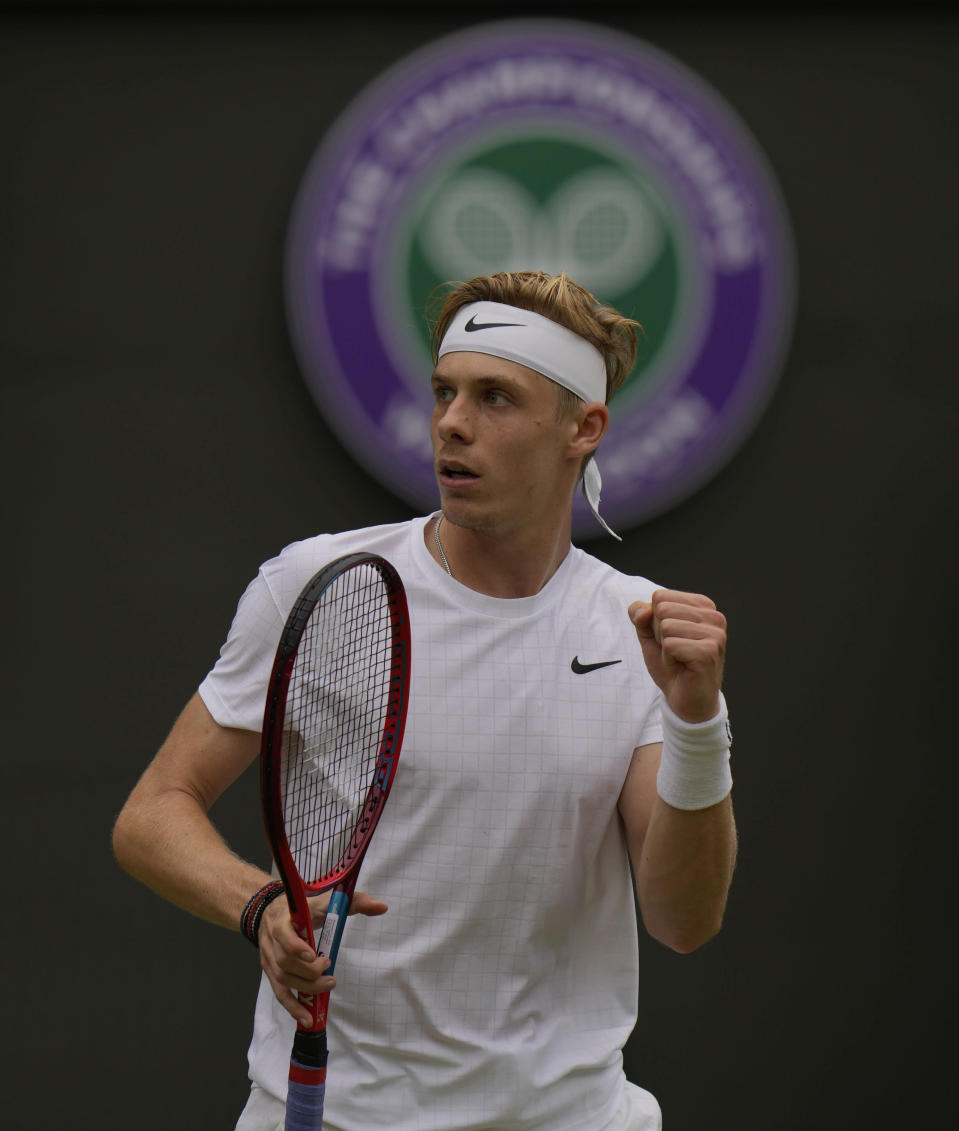Canada's Denis Shapovalov celebrates breaking Russia's Karen Khachanov's serve in the fifth set during the men's singles quarterfinals match on day nine of the Wimbledon Tennis Championships in London, Wednesday, July 7, 2021. (AP Photo/Alastair Grant)