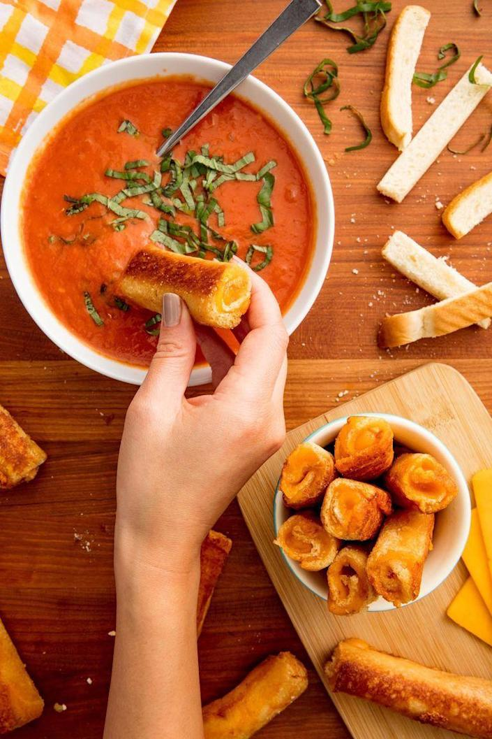 """<p>There's nothing more classic than a grilled cheese with tomato soup. This grilled cheese recipes prioritizes dipping in the best way possible. </p><p><em><strong>Get the recipe at <a href=""""https://www.delish.com/cooking/recipe-ideas/recipes/a49054/grilled-cheese-soup-dippers-recipe/"""" rel=""""nofollow noopener"""" target=""""_blank"""" data-ylk=""""slk:Delish."""" class=""""link rapid-noclick-resp"""">Delish.</a></strong></em></p>"""