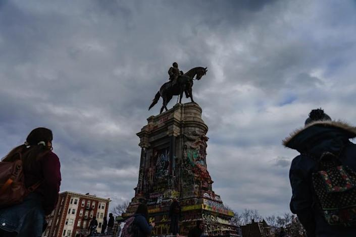 RICHMOND, VA. -- JANUARY 18, 2021: Black Lives Matter supporters stand around the Robert E. Lee Monument in Richmond, United States, on Monday Jan. 18, 2021. (Marcus Yam / Los Angeles Times)