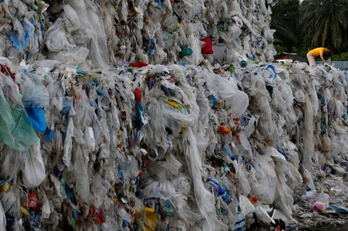 FILE PHOTO: Plastic waste are piled outside an illegal recycling factory in Jenjarom, Kuala Langat