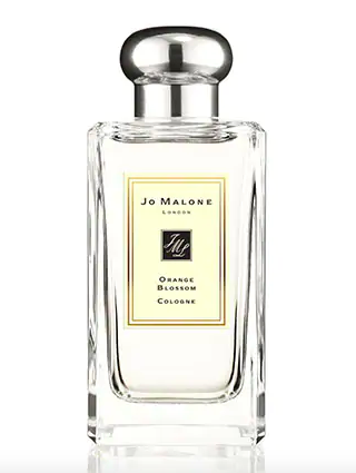 """<p><strong>Jacqueline Kilikita, Beauty Editor</strong></p><p><strong>The perfume: Jo Malone</strong> Orange Blossom Cologne, £94 for 100ml, available at <a href=""""https://www.jomalone.co.uk/product/3589/10106/fragrances/colognes/floral/orange-blossom-cologne/orange-blossom-cologne"""" rel=""""nofollow noopener"""" target=""""_blank"""" data-ylk=""""slk:Jo Malone"""" class=""""link rapid-noclick-resp"""">Jo Malone</a>.</p><p><strong>Why it's my signature scent:</strong> I sniffed this out in Duty Free on the way to visit my family in Cyprus a couple of years ago. It's basically a holiday in a bottle and every spritz reminds me of the sun-soaked orange trees that shade the marble table on the balcony. The top note is clementine flower, which then gives way to a squeeze of sharp lemon and dries down to a glug of warm honey. It's incredibly luxe and very moreish.</p><br><br><strong>Jo Malone London</strong> Orange Blossom Cologne, $94, available at <a href=""""https://www.jomalone.co.uk/product/3589/10106/fragrances/colognes/floral/orange-blossom-cologne/orange-blossom-cologne"""" rel=""""nofollow noopener"""" target=""""_blank"""" data-ylk=""""slk:Jo Malone"""" class=""""link rapid-noclick-resp"""">Jo Malone</a>"""