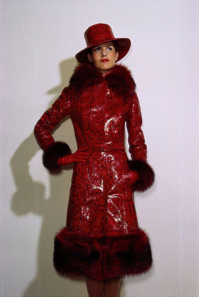 <p>Givenchy gifted the world with this red snakeskin leather jacket, outfitted with a red fur trim, along with matching hat and gloves. This streetwear would certainly make...a statement.<br></p>