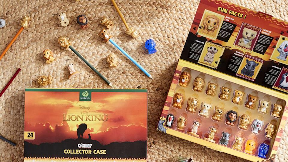 Pictured is the Woolworths Lion King Ooshies collection on a mat.