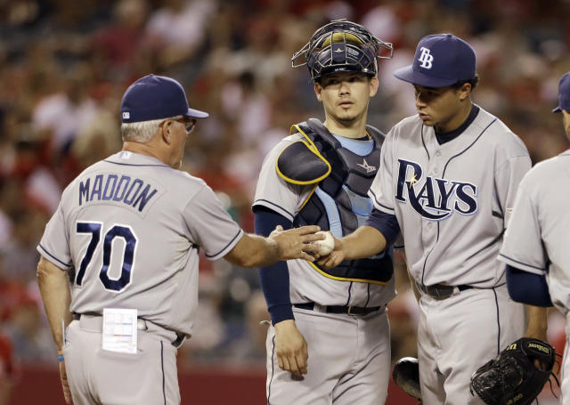 Tampa Bay Rays starting pitcher Chris Archer hands the ball to manager Joe Maddon as catcher Jose Lobaton watches in the fourth inning of a baseball game against the Los Agneles Angels in Anaheim, Calif., Monday, Sept. 2, 2013. (AP Photo/Reed Saxon)