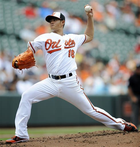 Baltimore Orioles starting pitcher Wei-Yin Chen, of Taiwan, delivers against the Oakland Athletics during the third inning of a baseball game, Sunday, July 29, 2012, in Baltimore. (AP Photo/Nick Wass)