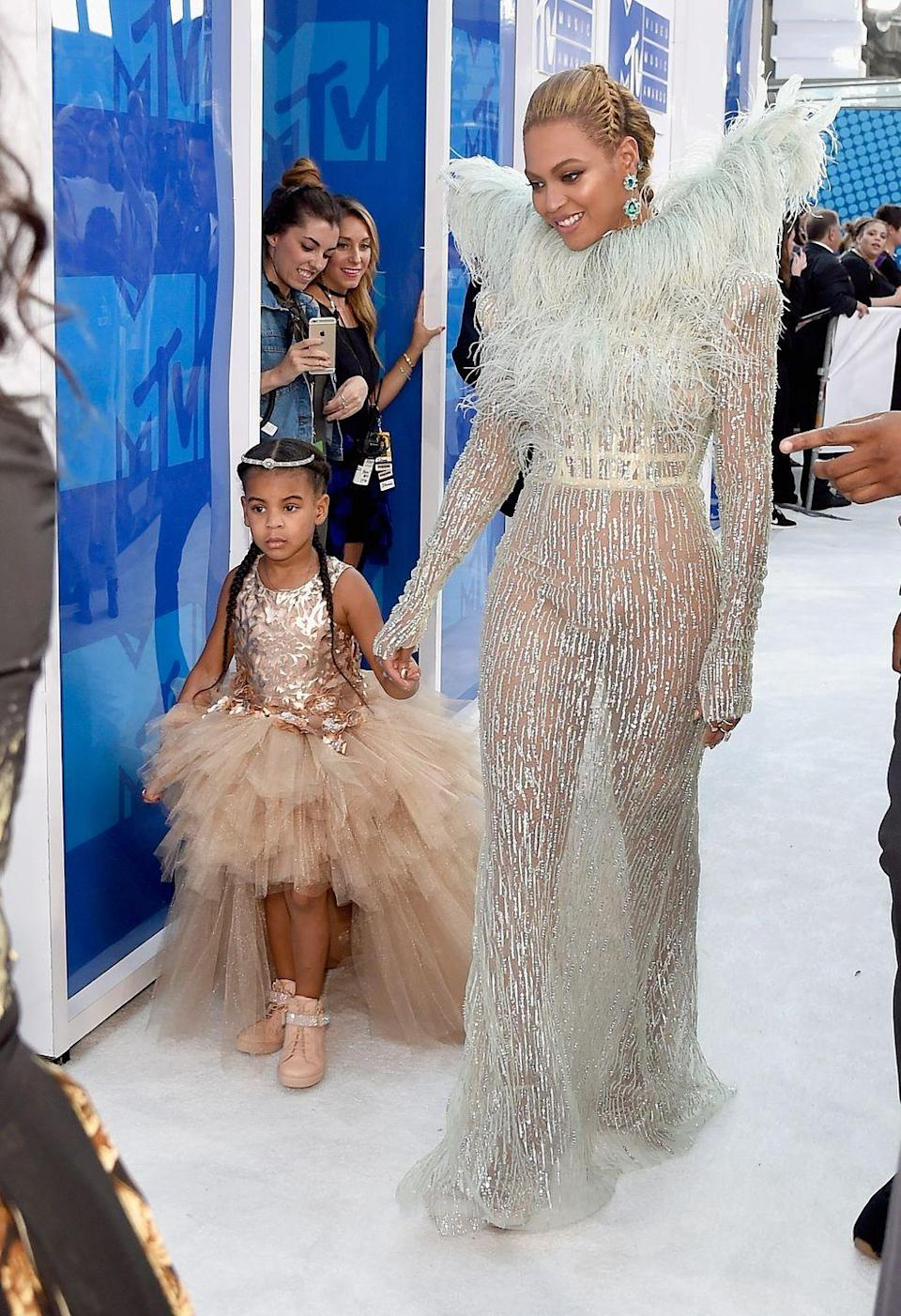 <p>Beyoncé and Blue Ivy arrived to the VMAs in 2016 with sparkly outfits that were bound to impress. Beyoncés added feathers and Blue Ivy's extra tulle differentiate the outfits while still allowing them to be the coolest mother-daughter duo. </p>