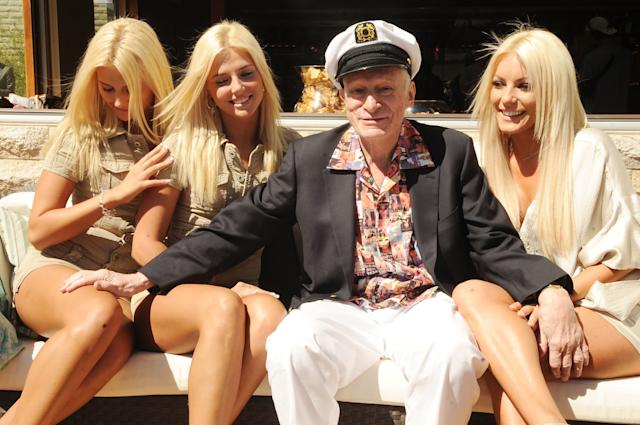Kristina and Karissa Shannon, Hugh Hefner and Crystal Harris attend Hugh Hefner's 83rd birthday pool party at the Palms Resort & Casino on April 4, 2009, in Las Vegas. (Denise Truscello via Getty Images)
