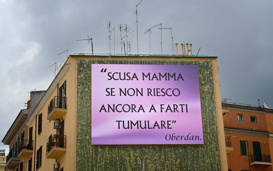 'I'm sorry Mum that I haven't been able to have you buried' say the giant billboards that have appeared in Rome - AFP