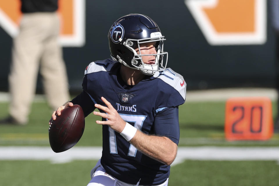 Tennessee Titans quarterback Ryan Tannehill (17) throw during the first half of an NFL football game against the Cincinnati Bengals, Sunday, Nov. 1, 2020, in Cincinnati. (AP Photo/Jay LaPrete)